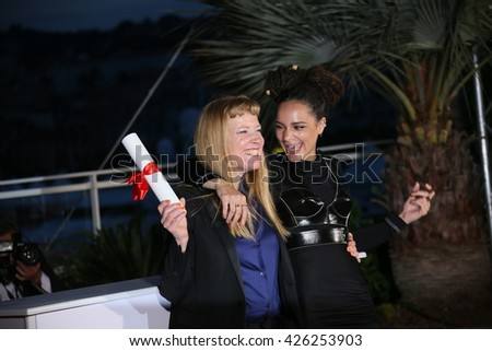 Andrea Arnold, Sasha Lane poses  the Palme D'Or Winner Photocall during the 69th annual Cannes Film Festival at the Palais des Festivals on May 22, 2016 in Cannes, France. - stock photo