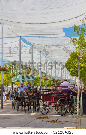 ANDUJAR,SPAIN - September, 6:  tents and umbrellas to avoid the sun during the famous Andalusian Horse Fair on September, 6, 2014 in Andujar, Spain - stock photo