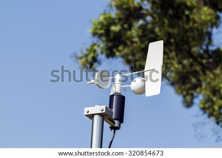 Anemometer and Devices meteorological station on the blue sky background - stock photo