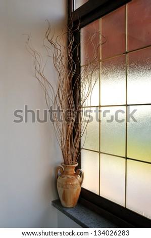 Anfora, amphora, near the window, art home - stock photo
