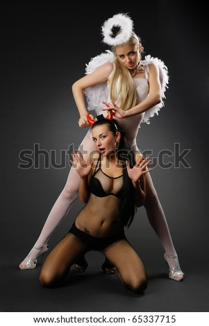 Angel and demon fight - stock photo