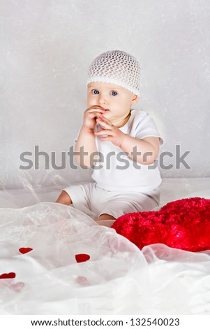Angel baby is eating something - stock photo