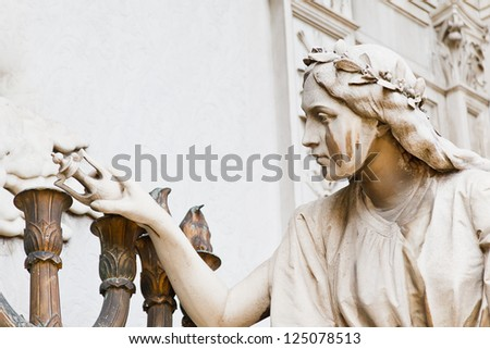 Angel crying at La Recoleta Cemetery in Buenos Aires, with room for text. - stock photo