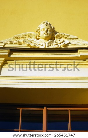 Angel face on the facade of Peter and Paul church. Historical city center of Saint-Petersburg, Russia. Popular touristic landmark, UNESCO World Heritage Site. - stock photo