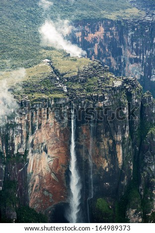 Angel Falls (top fragment) is worlds highest waterfalls (978 m), view from the plane - Venezuela, Latin America - stock photo