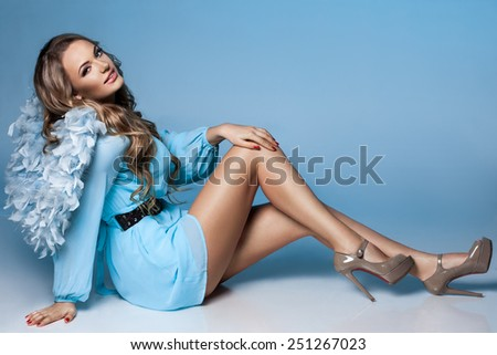 angel girl with blue wings - stock photo