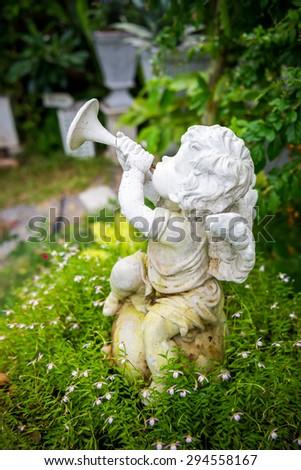 Angel in garden  - stock photo