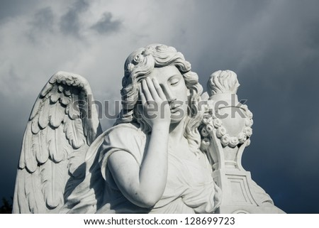 angel in the cemetery - stock photo