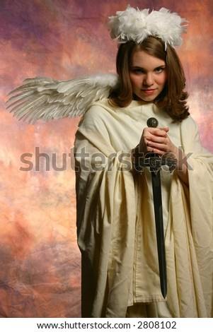 Angel of wrath looking at you - stock photo