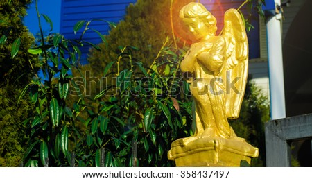 Angel on the background of the church - stock photo