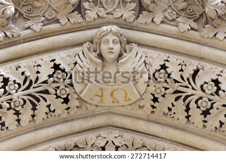 Angel on the portal of the cathedral dedicated to the Assumption of Mary and to kings Saint Stephen and Saint Ladislaus in Zagreb - stock photo