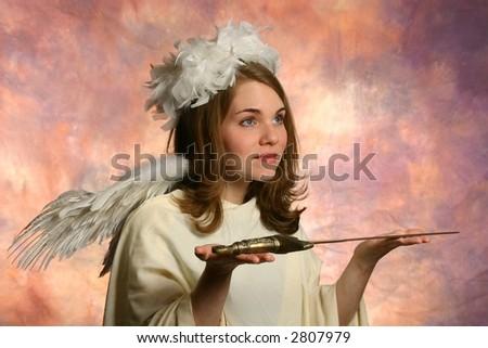 Angel presenting a sword - stock photo
