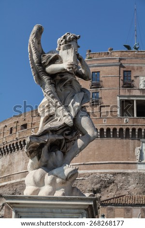 Angel sculpture in Sant'Angelo bridge, in front of Sant'Angelo castle in view of Vatican City, Rome, Italy - stock photo