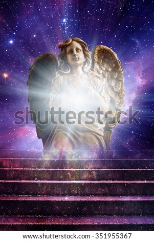 angel statue and stairs with divine light - stock photo