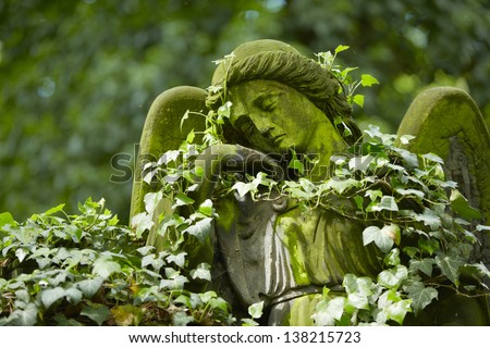 Angel statue on old cemetery - selective focus - stock photo