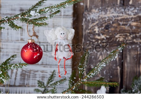 Angel toy hangng on fir tree - stock photo