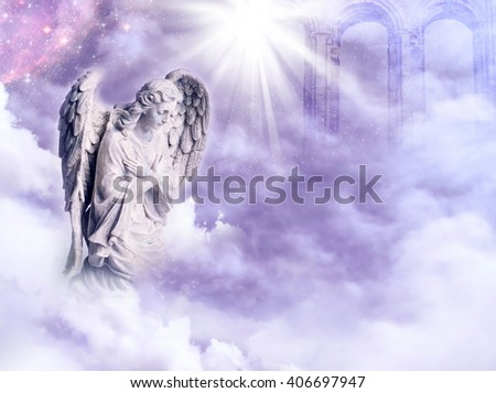 angel with a star and rays of light over a purple sky - stock photo