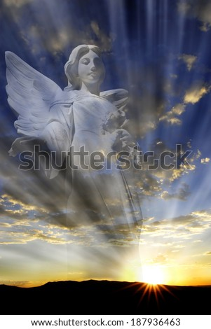 Angel with wings in front of heavenly light - stock photo