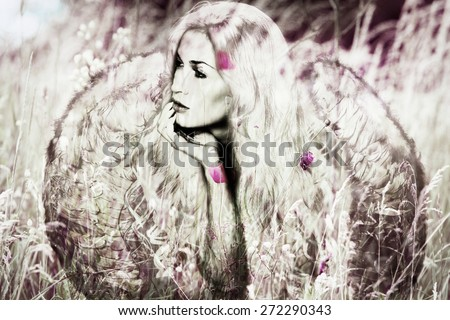 angel woman with wings in meadow,  composite image - stock photo