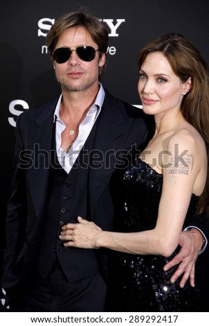 "Angelina Jolie and Brad Pitt at the Los Angeles premiere of 'Salt"" held at the Grauman's Chinese Theatre in Hollywood on July 19, 2010. - stock photo"