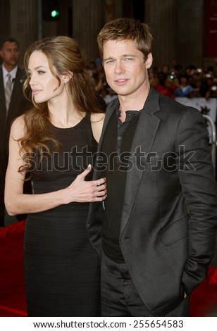 """Angelina Jolie and Brad Pitt attend the Los Angeles Premiere of """"Ocean's Thirteen"""" held at the Grauman's Chinese Theatre in Hollywood, California, on June 5, 2006.  - stock photo"""