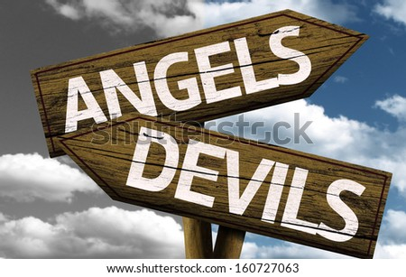 Angels x Devils creative sign with clouds as the background - stock photo