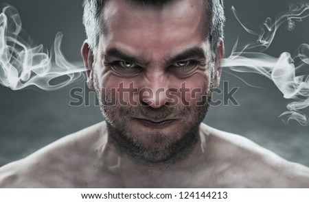 Anger, close up of angry man with smoke coming out from his ears - stock photo