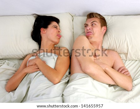 Anger couple fighting and discussing on bed.disagree couple on bed. - stock photo