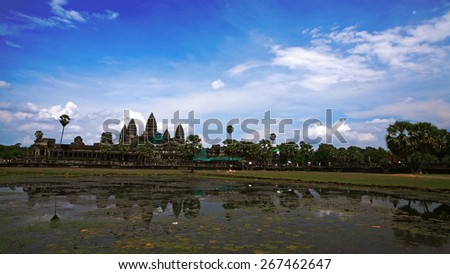 Angkor Wat against blue sky with reflection of water, Cambodia - stock photo