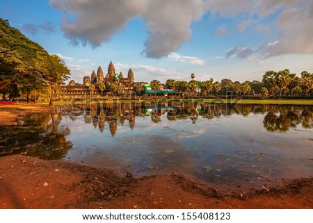 Angkor Wat in warm sunset light at Siem Reap. Cambodia - stock photo