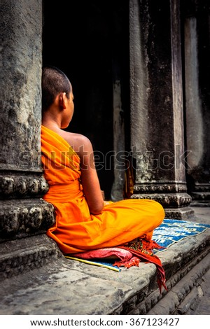 Angkor Wat monk. Ta Prohm Khmer ancient Buddhist temple in Cambo - stock photo