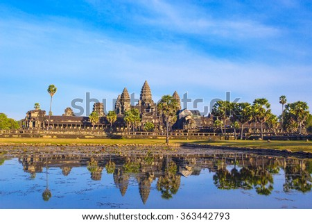 Angkor Wat Temple reflection in the pond water during the dry winter season, Siem Reap province, Cambodia - stock photo