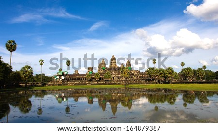 Angkor Wat. The temple area lies 5.5 kilometres (3.4 mi) north of the modern town of Siem Reap in Cambodia. - stock photo