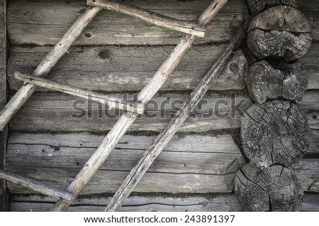 Angle old log home, close up - stock photo