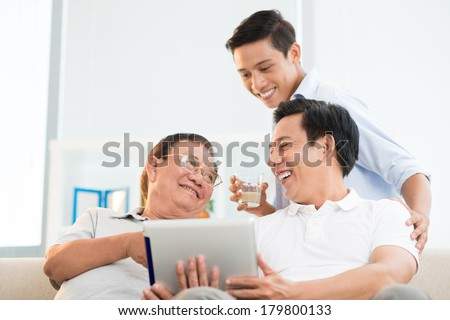 Angle view of a male family having fun at home on the weekend  - stock photo