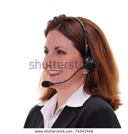 Angle view of a pretty woman at a call center. A service representative using a headset to speak to customers - isolated over white background. - stock photo