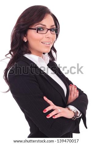 angle view of a young business woman holding her hands crossed and smiling to the camera. on white background - stock photo