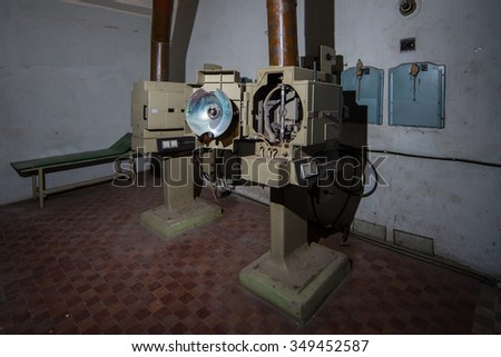 Angled 35mm movie projector images in projecting room - stock photo