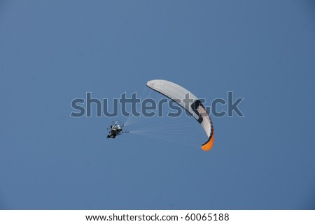 angled paraglider on a sunny day - stock photo