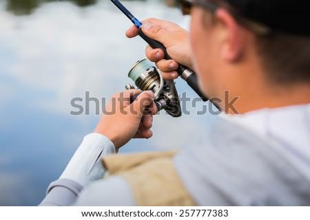 Angler fishing. - stock photo