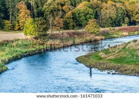 Angler fishing for Salmon on River Deveron at Turriff Bridge, Scotland. - stock photo