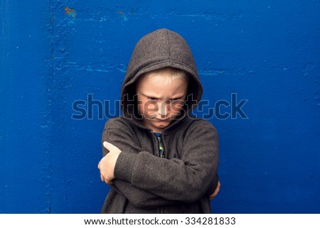 angry aggressive abused threatening rage boy (child, teen)   - stock photo