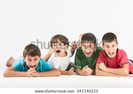 Angry and displeased many kids yelling and screaming - stock photo
