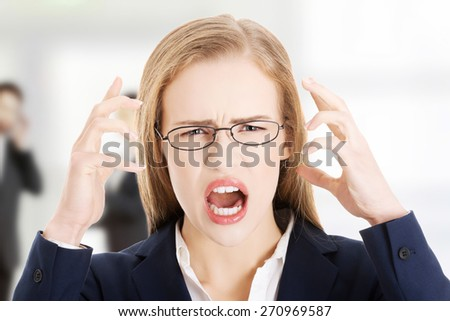 Angry and frustrated business woman yelling. - stock photo