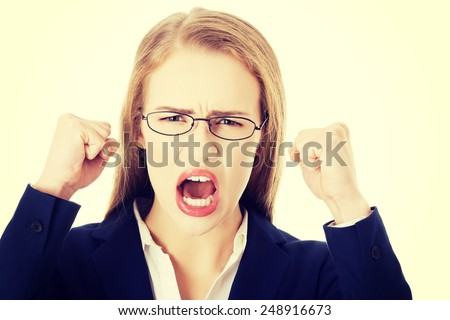 Angry and furious business woman with open mouth is screaming.  - stock photo