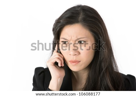 Angry Asian business woman talking on cell phone. Isolated on white. - stock photo