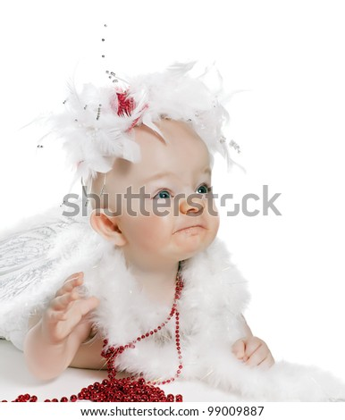 angry baby boy in a angel fancy dress - stock photo