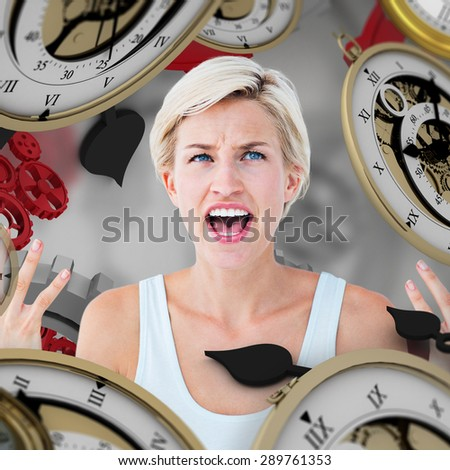 Angry blonde yelling with hands up against grey vignette - stock photo