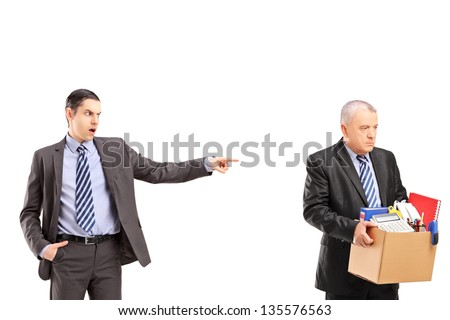 Angry boss firing an employee, isolated on white background - stock photo