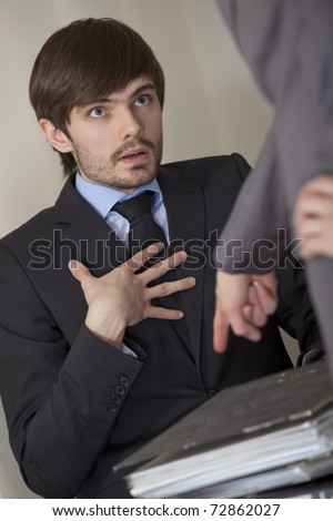 angry boss giving lots of paperwork to his assistant - stock photo